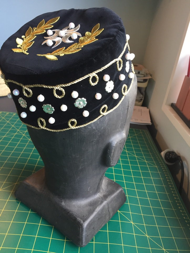 Black velvet cap.